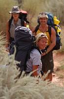 Three people hiking, adventure, Lake Powell, Arizona, Utah, USA