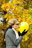 Woman is kissing a balloon