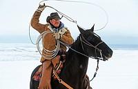 Cowboy roping with his lasso, Canada
