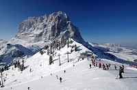 Skiers on a ski slope near the summit station, Mountain landscape in Winter, Sella Ronda, Gherdeina, Val Gardena, South Tyrol, Italy