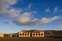 The historical building Casa de Los Coroneles under clouded sky, La Oliva, Fuerteventura, Canary Islands, Spain, Europe