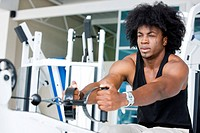 Man working out at the gym with an afro