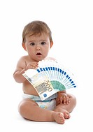 baby with money, symbolising child benefit