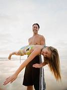 Man holding girl