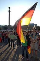 Football World Cup 2006: German Fans with flag, Stuttgart, Baden-Wuerttemberg, Germany