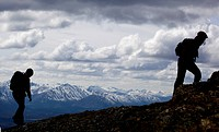 Silhouette of two young woman hiking, Mt. Lorne, Mountains, Pacific Coast Ranges behind, Yukon Territory, Canada, North America