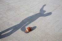 Shadow throwing an American football
