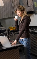 young woman with cup of coffee and notebook