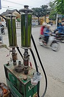 Asia, Vietnam, Hoi An  Hoi An old quarter  Small volumes of petrol for the many small motorbikes are sold almost everywhere  The historic buildings, a...