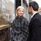couple in front of shop window