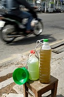 Small volumes of petrol for the many small motorbikes are sold almost everywhere, Nha Trang, Vietnam