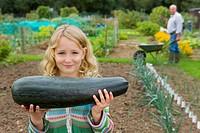 Girl holding large squash