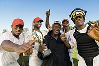 Baseball team and coach celebrating victory outdoors portrait
