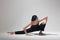 woman doing yoga, studio
