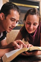A Christian couple reading together