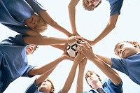 Soccer team in a huddle