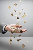 Businessman catching coins
