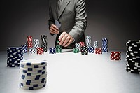 Businessman with gambling chips and poker cards