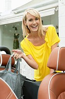 Woman smiling near a car after shopping