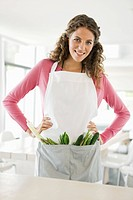 Woman standing with vegetables in the kitchen