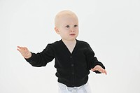 Close_up of a baby boy gesturing