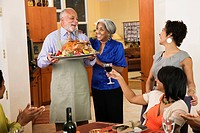 African American man serving Thanksgiving turkey