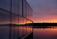 Sunset over lake near modern house