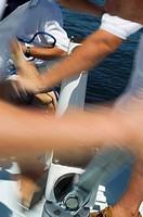 Sailors operating windlass on yacht close up of arms