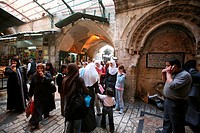 Veiled women gather at a market in the old city section of Jerusalem