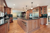 Kitchen in luxury home with black marble countertops