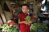 Young monk at a vegetable store  Buddhist monks are living in monastries in and around Kathmandu  Many are illegal refugees from Tibet but live quietl...