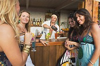 people being served at a bar