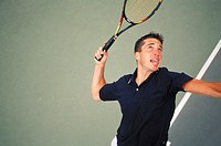 High angle view of a man playing tennis