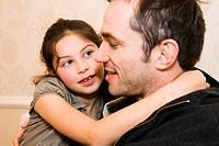 Mid adult man hugging his daughter