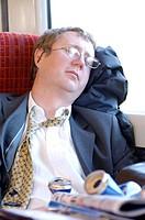 tired commuter on train asleep