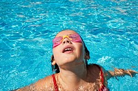 Girl with goggles on a swimming pool in Ludiente, Castellón