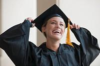 Caucasian graduate in cap and gown