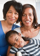 Black grandmother smiling with daughter and granddaughter