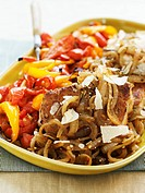 Pork chops with onions, peppers and Parmesan