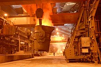 Man uses remote control to tip a huge vat of molten steel in steel making process, SSAB Swedish Steel Ab, Lulea, Sweden