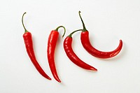 Perfectly fresh red hot peppers on white  Professionally retouched high quality image
