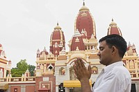 Man praying in front of a temple, Laxminarayan Temple, New Delhi, India
