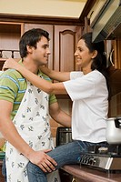 Couple romancing in the kitchen