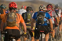 A group of racers leave the start gate at a mountain bike race just North of Kamloops in the Thompson Okanagan region of British Columbia, Canada