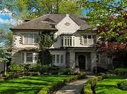 Beautiful family house springtime scenery. Baby Point neighbourhood Toronto Ontario Canada.