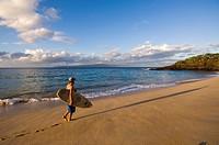 Surfer on Makena Beach or Big Beach, Maui, Hawaii, United States