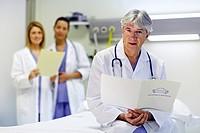 Doctor and nurses in a hospital room. Hospital Policlinica Gipuzkoa, San Sebastian, Donostia, Euskadi, Spain