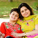 Portrait of a mid adult woman and her son smiling