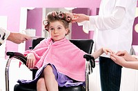 portrait of young girl at hair salon being served