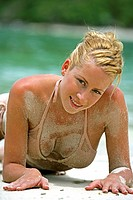 sexy blond young woman relax on tropical beach in Thailand
